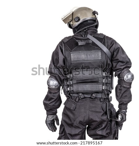 Spec ops soldier in black uniform and face mask shot from behind