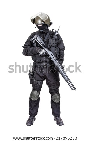 Spec ops soldier in black uniform and face mask with shotgun