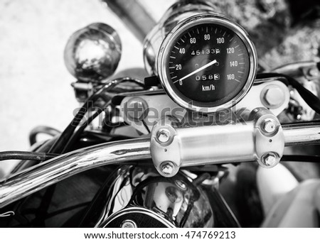 speedometer (gauge) of classic motorcycle - vintage film grain back and white color effect