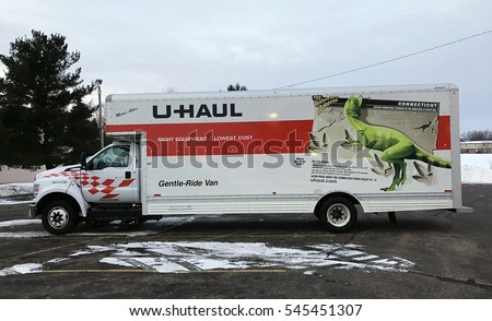 Spencer, Wisconsin, December, 30, 2016  U-Haul renatal moving truck on a snow covered parking lot