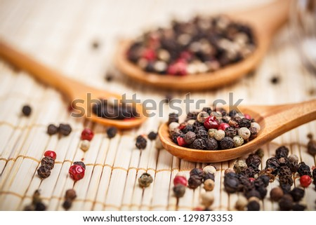 Spicy peppercorns in a wooden spoon