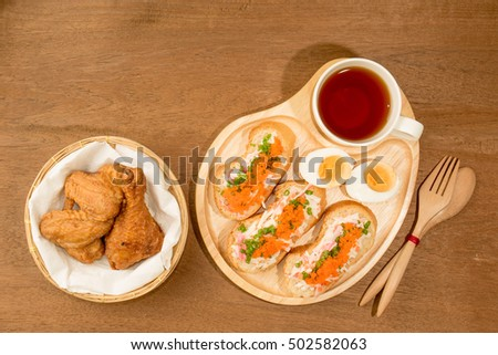 Spicy Shrimp eggs Baguette served with Fried Chicken