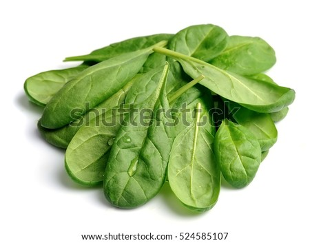 Spinach leaves close up isolated on white.