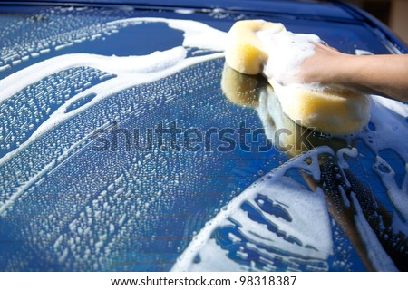 sponge over the car for washing