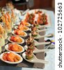Spoons with seafood snacks -  banquet dish - stock photo