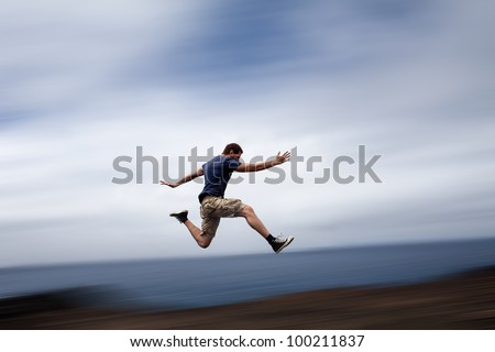 Sport and energy concept - athletic man running fast