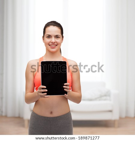 sport, exercise, technology, internet and healthcare - sporty woman with tablet pc blank screen