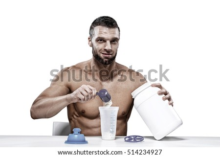Sport, fitness, healthy lifestyle and people concept - close up of man with jar and bottle preparing protein shake. Sport concept image. isolated on white background