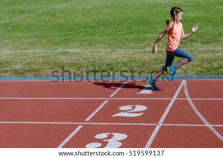 Sport for kids, active child running on stadium track, little girl training, fitness concept