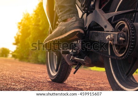 sport motorbike on the side of the road. Biker ready to run