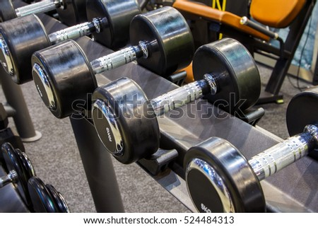 Sports dumbbells in modern sports fitnes club. Weight Training Equipment