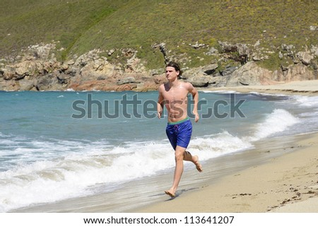 sportsman working out on the beach