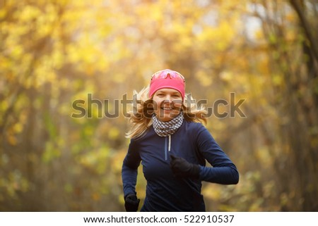 Sportswoman in shoes among leaves