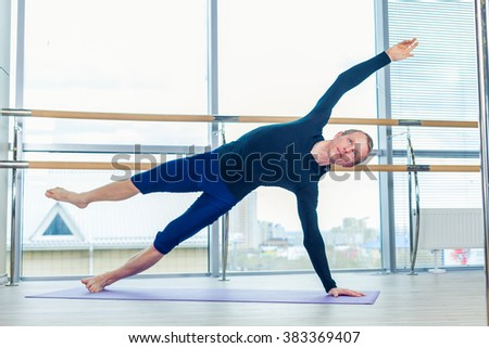 pilates woman reformer teaser exercise gym stock photo