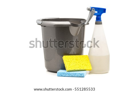 Spray bottle, bucket and sponges household cleaning products over white background