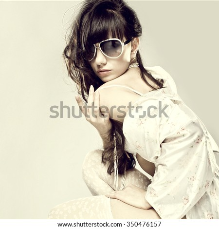 Spring Fashion portrait of a beautiful young sexy womans wearing sunglasses