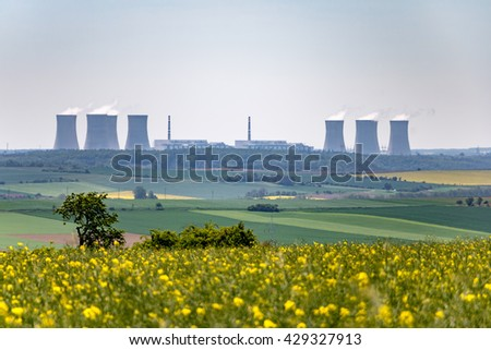 Spring landscape with nuclear power plant on horizon. Czech Republic, Europe.
