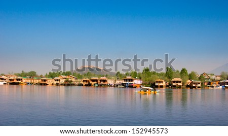SRINAGAR, INDIA - April 15: Lifestyle in Dal lake with beautiful houseboat background,local people use 'Shikara',a small boat for transportation in the lake, April 15, 2012 in Srinagar, Kashmir, India