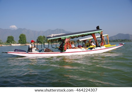 SRINAGAR, INDIA - JULY 3, 2016 : Local people use small boats called shikara to transport tourists on the Nagin lake in Srinagar in Kashmir, India