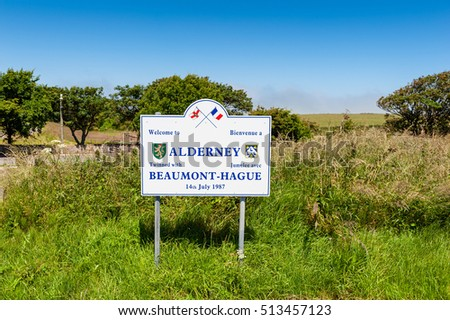 ST. ANNE, UNITED KINGDOM  JULY 6: Bilingual welcome sign near the airport of Alderney, Channel Islands, UK on July 6, 2013. The Channel Islands are an archipelago in the English Channel.