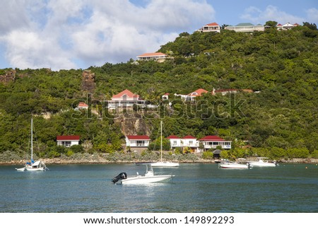 ST BARTS, FRENCH WEST INDIES - NOVEMBER 5: Expensive villas and boats at St. Jean Bay on November 5, 2012 at St Barts. The island is popular tourist destination during the winter holiday season