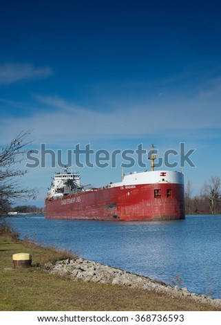 St. Catharines, Ontario, Canada - November 30, 2015: The CSL Niagara self-discharging bulk carrier between Lock 1 and Lock 2 while navigating south on the Welland Canal.