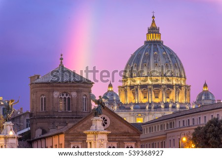 St peter's basilica in Rome,Vatican, the dome at sunset, with rainbow on a cloudy sky