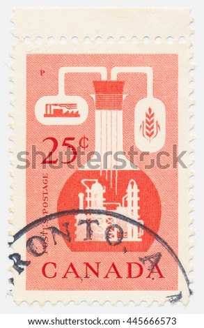 ST. PETERSBURG, RUSSIA - JUNE 30, 2016: A postmark printed in CANADA, shows bulb, ear, plant, Chemical Industry, circa 1956