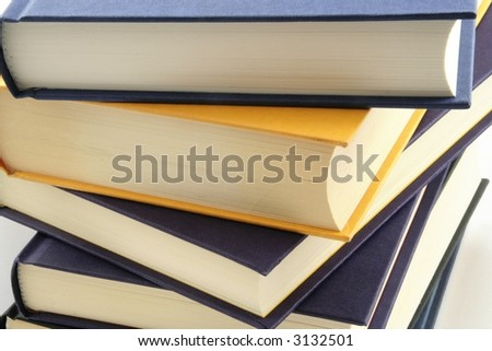Stack of books against a white background
