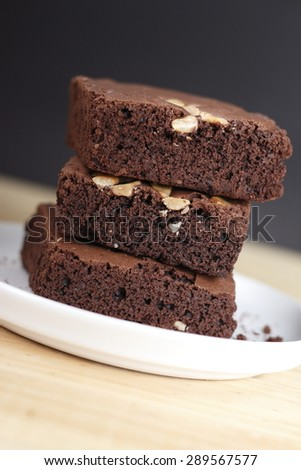 stack of brownies on white dish