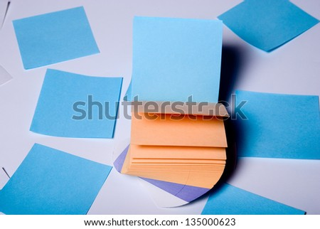 Stack of colorful. Paper records lying on a light background