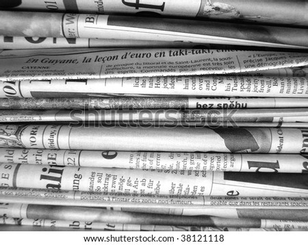 Stack of international newspapers - in black and white