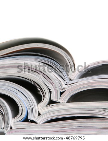 Stack of magazines isolated on white background-vertical image