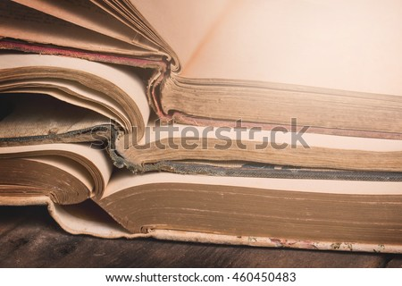 Stack of Open Vintage Books with Blank Pages