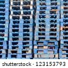 Stack of piled blue rough wooden euro pallets background texture pattern - stock photo