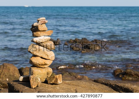 Stack of stones on beach, sea and sky, natural background