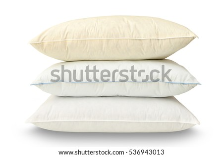 stack of three pillows of different color on a white background
