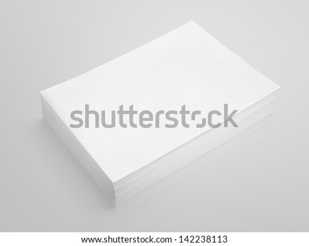 Stack of white paper on gray background with clipping path