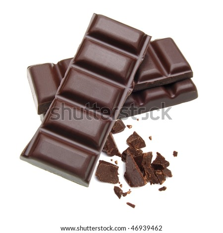 Stacked dark chocolate bars with crushed pieces on white background