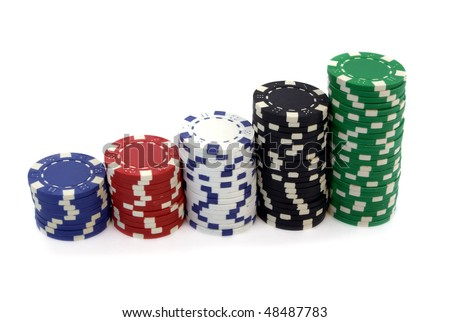 stacks of poker colorful chips isolated over white