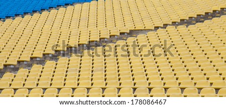 Stadium seats in yellow and blue color.