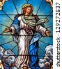 Stained glass window depicting Catholic devotion of Assumption of Blessed Virgin Mary into Heaven - stock photo