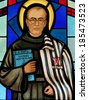 Stained glass window depicting St. Maximilian Kolbe, a Franciscan priest who died in the concentration camp of Auschwitz, Poland; patron saint of drug addicts, political prisoners and journalists - stock photo