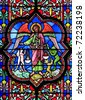 Stained glass window in Bayeux cathedral depicting the final judgment, France - stock photo