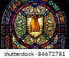 Stained glass window with symbol of