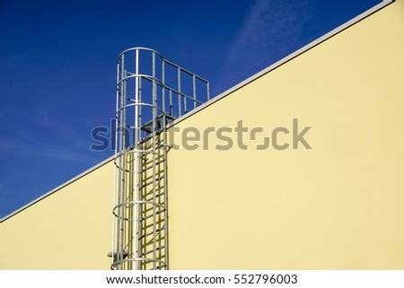stair for fire escape with the steel wall of the factory building