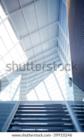 Stair in a blue tone color in glass business building