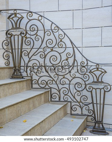 Staircase with pattern wrought-iron grating outdoors
