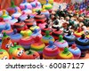 Stall of colored pottery at a village fair - stock photo