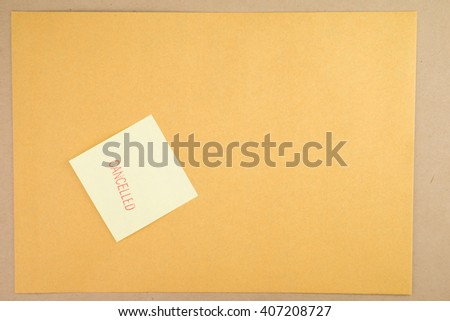 Stamp cancelled on blue post it note/on brown envelope.